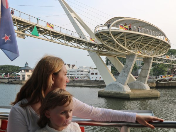 Mother and daughter sightseeing on boat