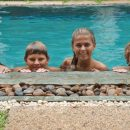 Family bobbing heads in the pool