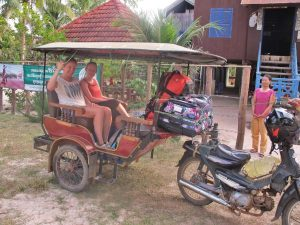 Friends on tuk tuk in countryside