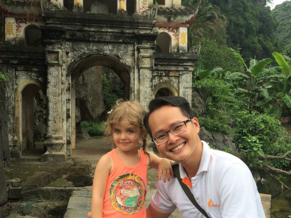 Young girl smiling with local guide
