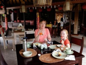 Mother and daughter eating breakfast