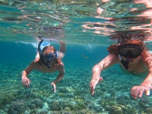 Kids snorkelling in the sea