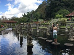 Young boy waving hands on water palace