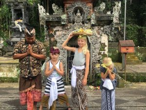 Family praying with local guide