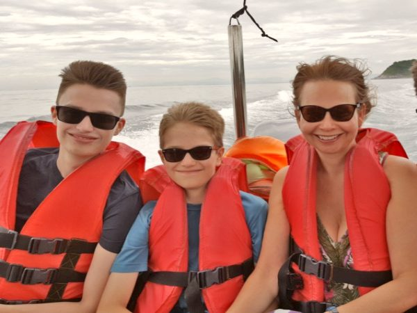 Family on boat ready for family trip