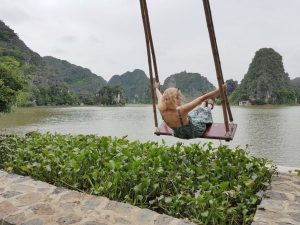 Woman on swing through lake