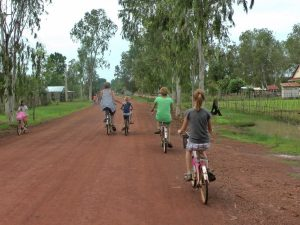 Family cycling through countryside