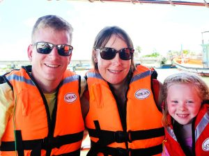 Family smiling with lifejackets