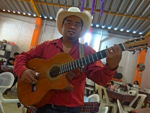 A local man playing guitar in Oaxaca