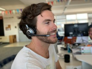 Man smiling on headset