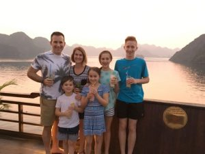 Family on junk boat with sunset
