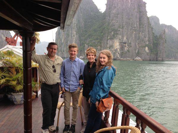 Family on boat with halong bay
