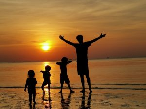Family outline in front of sunset