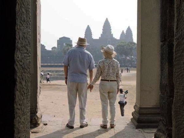 Two people in front on Angkor Wat