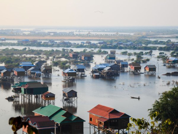 stilted houses on tonle sap lake, cambodia