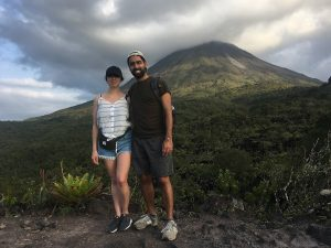 Couple standing in front of arenal volcano