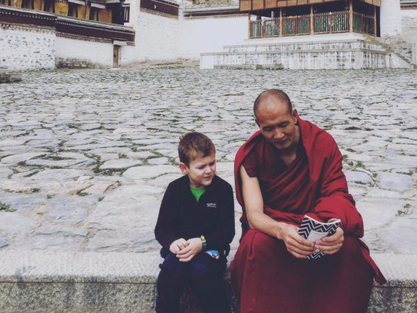 little boy with a monk