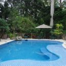 pool and bar in hotel near tikal