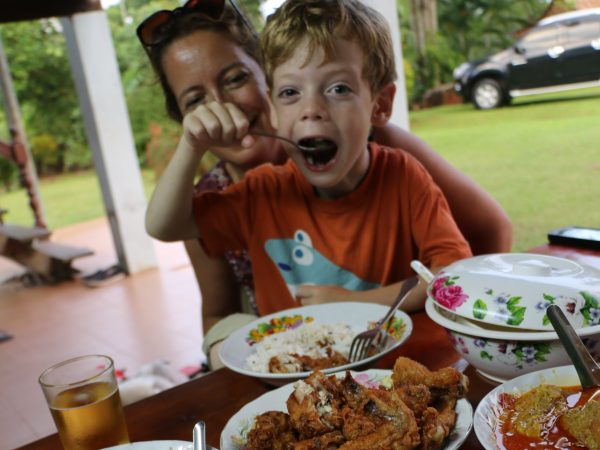 Young boy eating traditional Thai lunch