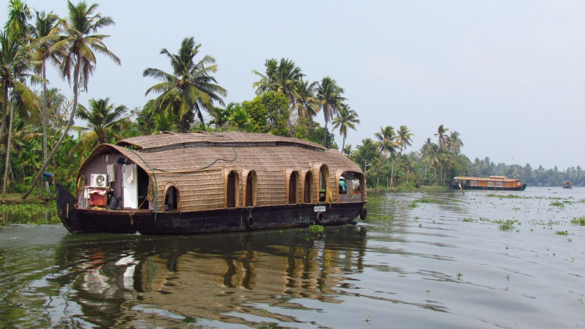 house boat floating on river bank