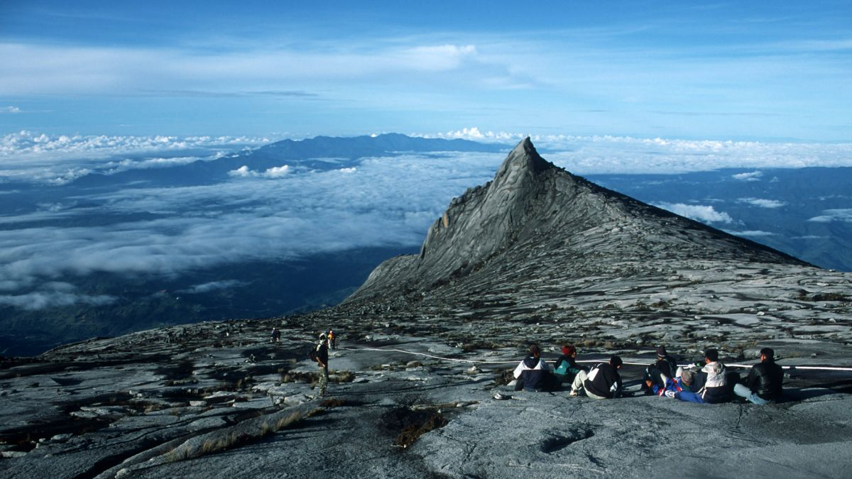 Tip of mount Kinabalu in the clouds