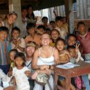 lady with local kids in thailand