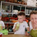 Woman and kids sipping drinks