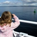Girl whale-watching in Campbell River, Canada