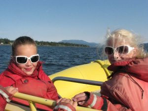 Two girls on boat in Campbell River, Canada