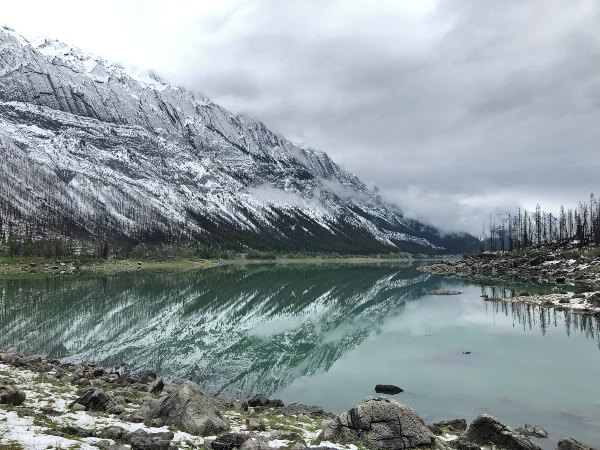 snowy mountain peaks and crystal water
