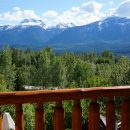 Snow peak mountains with wooden fence