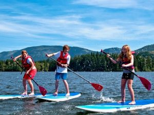 Family stand up paddle boarding