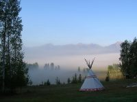 Tipi tent in misty mountains