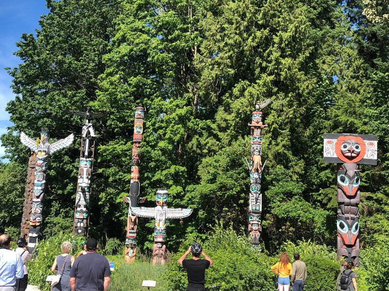 Totem poles in the forest