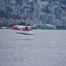 Sea plane hovering over body of water