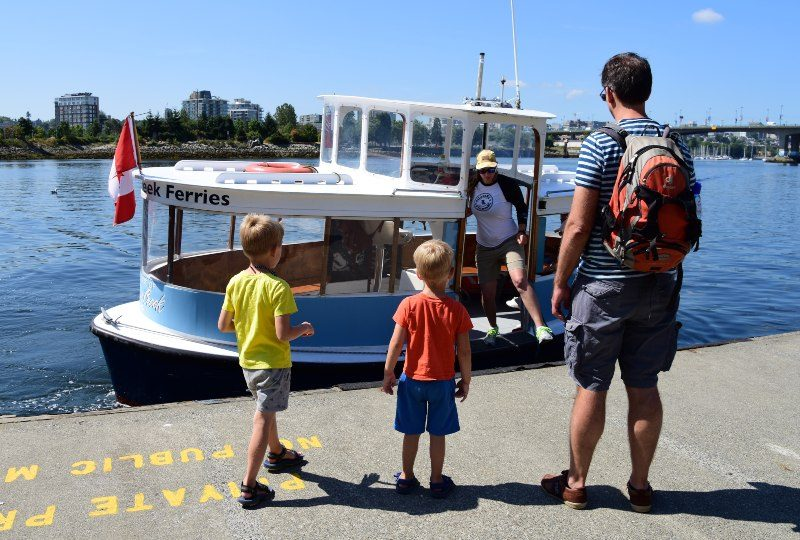 Family standing in Marina waiting for boat