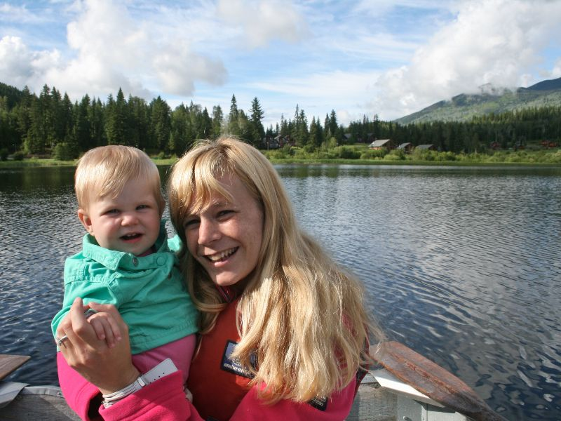 Woman holding baby both smiling