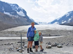 Mother and sons in front of glacier