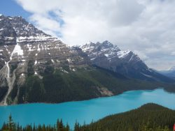 snowky peak mountains with ice blue water
