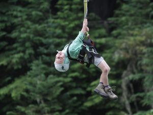 child hanging on zipline