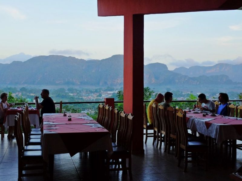 Table and chairs set up for dining with beautiful scenic view of mountains