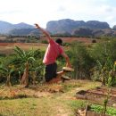 man jumping in the air in vinales, cuba
