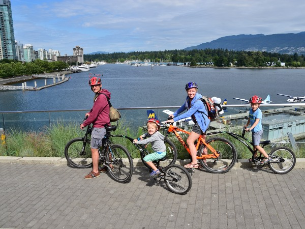 Family riding bike near body of water