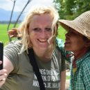 traveller taking photo with Burmese woman