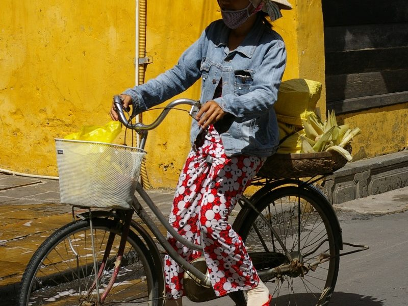 local lady on bicycle in Hoi An