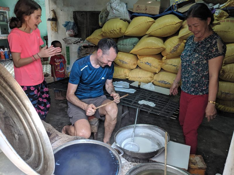 People making noodles in a bowl from scratch
