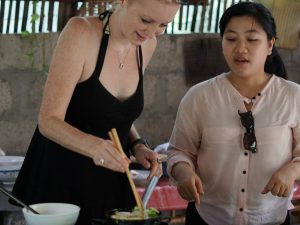 traveller learning to cook with a local woman in vietnam