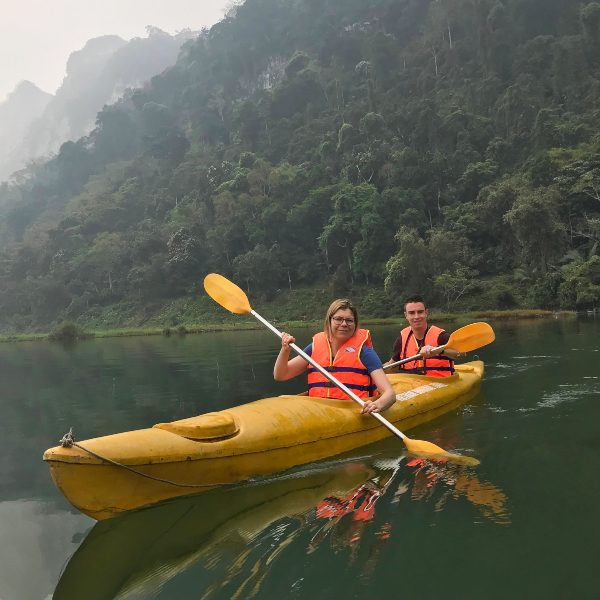 couple kayaking across lake in ba be national park