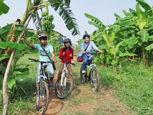 Family cycling on Koh Dach, Cambodia