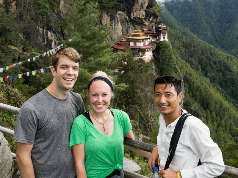 Couple with guide standing in front of tigers nest